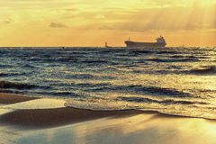 Ships at sunset in the Baltic sea Royalty Free Stock Photos