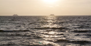 Ships in sunset sea Stock Photography
