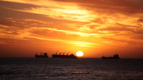 Ships at Sunset, Timelapse. Cargo Ships at Sunset, Chile stock video footage