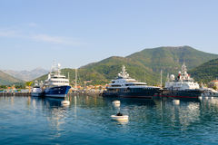 Ships in Tivat Bay on background of mountains, Montenegro Stock Images