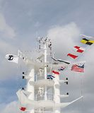 Ships Tower And Flags Royalty Free Stock Photos