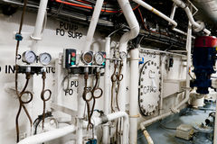 Ships valves, main engine - engineering interior Stock Photos