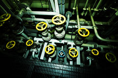 Ships valves, main engine - engineering interior. Royalty Free Stock Photography