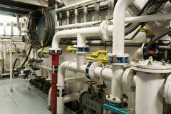Ships valves, main engine - engineering interior. Royalty Free Stock Photos