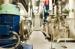 Ships valves, main engine - engineering interior. Stock Photos