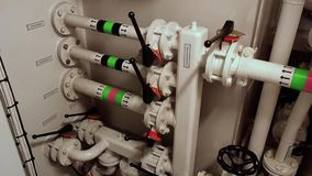 Ships valves, main engine - engineering interior. Valves in Vessel`s. Engine Room Space stock video