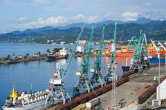 Ships, wagons and cranes in seaport Royalty Free Stock Photography