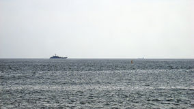 Ships. A warship on the horizon Royalty Free Stock Images
