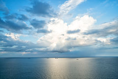 Ships on water with cloudy sky Stock Photography