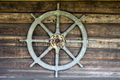 Ships wheel. Old ships wheel on the wall Stock Photography