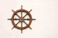 Ships Wheel. Ornamental ships wheel mounted on a wall stock image