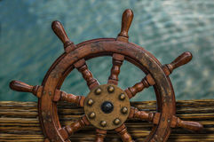 Ships Wheel Against Ocean Water Royalty Free Stock Photography