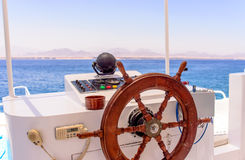 Ships wheel and navigation console Stock Photos