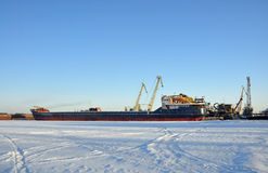 Ships on the winter Parking lot. The Volga river is frozen stock photography