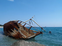 Shipwreck 1. A rusty ship wreck on beach Stock Image