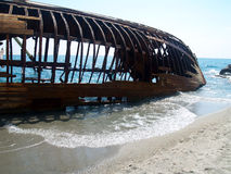 Shipwreck 2. A rusty ship wreck on beach Stock Image