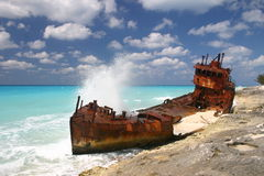 Shipwreck. Ed boat on a sandy shore Royalty Free Stock Image