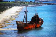 Shipwreck. A rusted shipwreck just off a beach Royalty Free Stock Photo