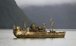 Shipwreck. MV Logos, Rusty old shipwreck at the Beagle Channel, Chile Stock Photography
