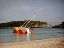 Shipwreck. Rescuing a yacht in a beach of Majorca (Balearic Islands) after a big storm in the Mediterranean Sea Royalty Free Stock Images