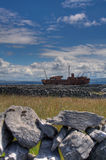 Shipwreck. The cargo ship MV Plassey on the shoreline at Inisheer Island in Ireland after being shipwrecked during a storm in the 1960s royalty free stock image