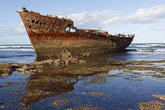 Shipwreck on african coast. Photo of a rusted shipwreck on the west african coast Royalty Free Stock Photo