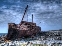 Shipwreck on the Aran Islands. A shipwreck on the island of Inisheer, Aran Islands, Ireland. Famous from the opening credits of 'Father Ted Royalty Free Stock Images