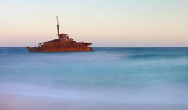 Shipwreck on beach. A shipwreck close to the shore taken at dusk Royalty Free Stock Photo