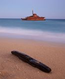 Shipwreck on beach. A shipwreck close to the shore taken at dusk Royalty Free Stock Photography