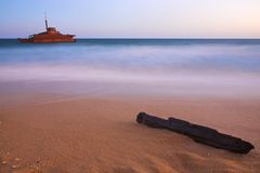 Shipwreck on beach. A shipwreck close to the shore taken at dusk Royalty Free Stock Image