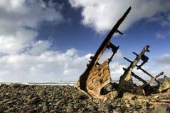 Shipwreck on beach Stock Photos