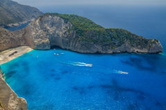 Shipwreck Beach, Navagio in Zakynthos, Greece. Navagio - the most famous beach on Zakynthos island with shipwreck and anchoring boats (Greece, Ionian islands Royalty Free Stock Image