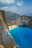 Shipwreck Beach, Navagio in Zakynthos, Greece. Navagio - the most famous beach on Zakynthos island with shipwreck and anchoring boats (Greece, Ionian islands Stock Photo