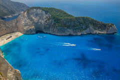 Shipwreck Beach, Navagio in Zakynthos, Greece. Navagio - the most famous beach on Zakynthos island with shipwreck and anchoring boats (Greece, Ionian islands Stock Image