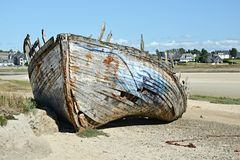 Shipwreck on the beach. Old shipwreck on beach in France Royalty Free Stock Images