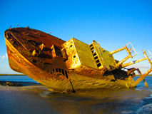 Shipwreck on a beach. An old grounded shipwreck on a beach in Mozambique Stock Photo
