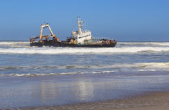 Shipwreck on a beach, Skeleton Coast. Namibia Royalty Free Stock Photography