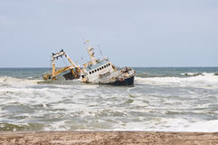 Shipwreck on beach, Skeleton Coast. Namibia Royalty Free Stock Images