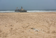 Shipwreck on beach, Skeleton Coast, Namibia Royalty Free Stock Photography