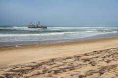 Shipwreck on beach, Skeleton Coast, Namibia Royalty Free Stock Photo