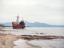 Shipwreck in a beach. Small shipwreck on the beach left there for years, Gytheio, Greece Stock Photo