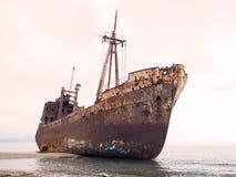 Shipwreck in a beach Stock Photos