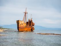 Shipwreck in a beach. Small shipwreck on the beach left there for years, Gytheio, Greece Stock Photos
