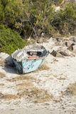 shipwreck on beach, white sand, stones, plant around Stock Photos
