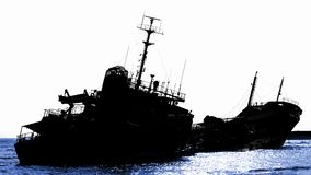 Shipwreck of a Beached Diesel Tanker in Silhouette Royalty Free Stock Image