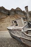 Shipwreck and cliffs in Skansbukta, Svalbard Royalty Free Stock Image