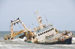 Shipwreck on coast, Namibia. Shipwreck on Skeleton Coast, Namibia Royalty Free Stock Photos