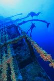 Shipwreck and divers Stock Photos