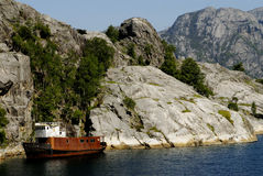 Shipwreck in fjord. Picture of shipwreck in fjord near rocky coast Royalty Free Stock Image
