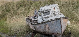 Shipwreck in Homer Alaska. An old abandoned shipwreck in Homer, Alaska Stock Photo
